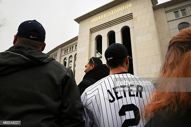 Yankee fans prepare to enter Yankee Stadium for the 2014 home opener game on April 7, 2014 in New York City. The Monday afternoon game against the...