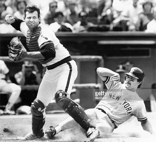 Yankee first baseman Don Mattingly is forced out at home plate by Angels catcher Bob Boone during 4th inning play at Anaheim Stadium Following the...