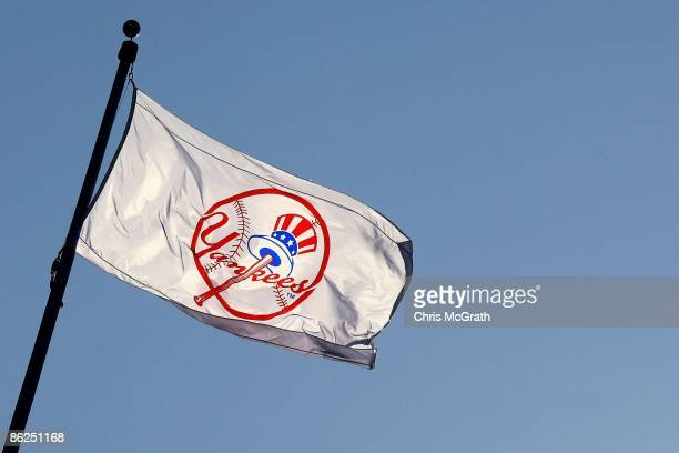 Yankee flag waves over the new stadium during opening day between the New York Yankees and the Cleveland Indians at the new Yankee Stadium on April...