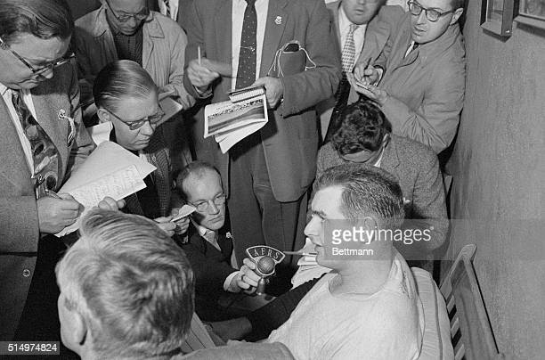 Yankee hurler Don Larsen is surrounded by newsmen in his dressing room at Yankee Stadium after the 27yearold right hander pitched the first perfect...