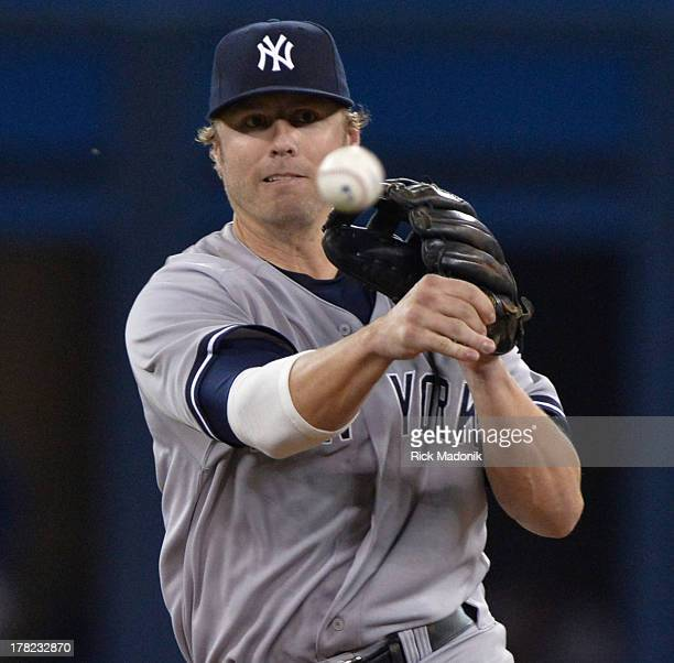 Yankee infielder Mark Reynolds throws to 1st for an out. Toronto Blue Jays host New York Yankees at Roger's Centre in Toronto, onAugust 27, 2013....