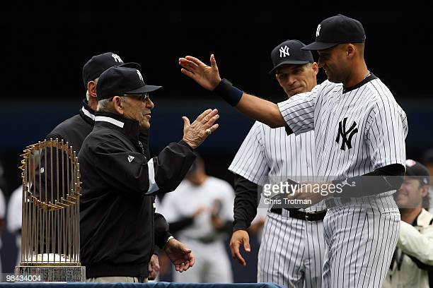 Yankee legend and Baseball Hall of Famer Yogi Berra presents Derek Jeter of the New York Yankees with his World Series ring for the 2009 season prior...