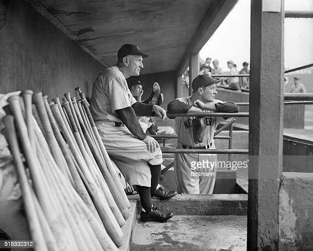 Yankee manager Casey Stengel and pitcher Joe Page watch the rainfall that dropped them another half-game in the torrid American League pennant fight....
