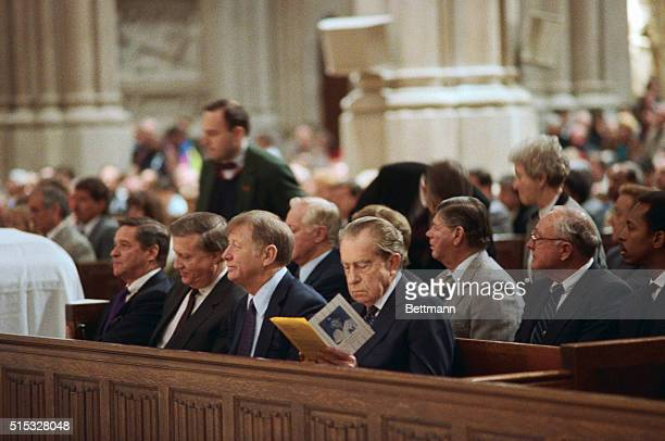 Yankee owner George Steinbrenner Hall of Famer Mickey Mantle and former President Richard Nixon attend funeral services for Billy Martin at St...