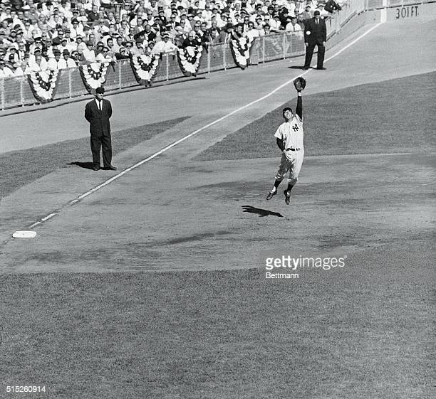 Yankee Stadium New York Out Of Reach New York Yankee third baseman Gil McDougald leaps high off the ground in an attempt to catch Dick Groat's...