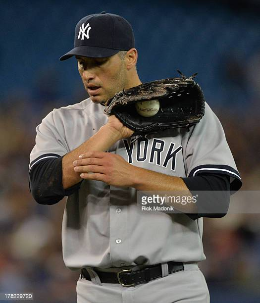 TORONTO ON AUGUST 27 Yankee starter Andy Pettitte after snagging a hot come backer Toronto Blue Jays host New York Yankees at Roger's Centre in...