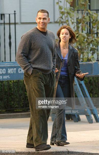 Yankee third baseman Alex Rodriguez and an unidentified woman walk through Central Park October 11 2004 in New York City