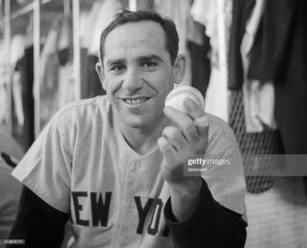 Yankee Yogi Berra set a new home-run record for catchers when he hit the 237th homer of his career during the 5th inning of the New York-Detroit game on September 14th. In this photograph, Berra holds the ball which he hit to make the new record.