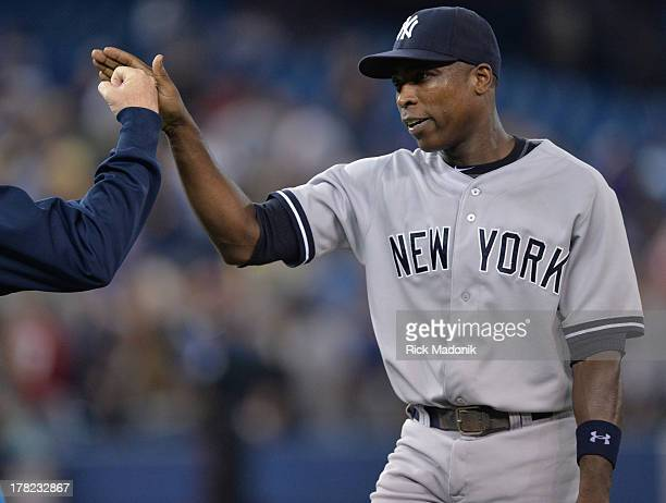 Yankees Alfonso Soriano, who recorded his 400th home run tonight, hi fives with a teammate after the game. Toronto Blue Jays host New York Yankees at...