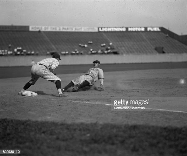Yankees Babe Ruth safe at third in fourth inning on Bob Meusel's fly out. Senators third baseman is Ossie Bluege in 1925. Senators won 8-1.