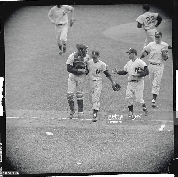Yankees catcher Elston Howard left and Bobby Richardson right greet their teammate and pitcher Bobby Shantz after their win against the Detroit...