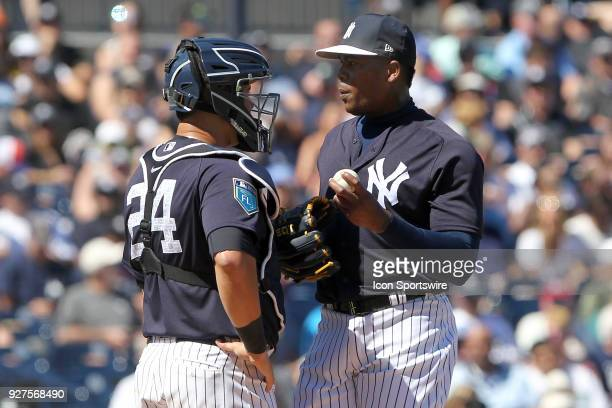 Yankees catcher Gary Sanchez has a word with pitcher Aroldis Chapman during the game between the Tampa Bay Rays and the New York Yankees spring...