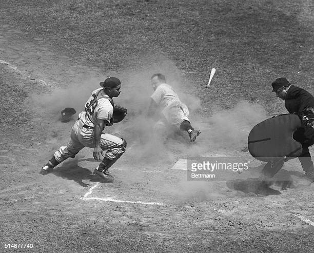 Yankees catcher Yogi Berra slides into home after Ferris Fain tripled, during the second inning of the 1951 All-Star Game. Dodgers catcher Roy...