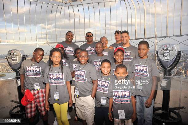 Yankees CC Sabathia, Mike Harkey, Tony Pena, Freddy Garcia, and Jorge Posada, along with Haitian school children fron the Ss. Joachim and Anne's...