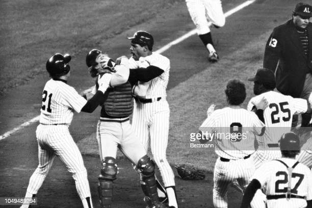 Yankees Dave Winfield screams at Oakland catcher Mike Heath as he hit him in the face as he knocks Heath to the ground in the 1st inning at Yankee...