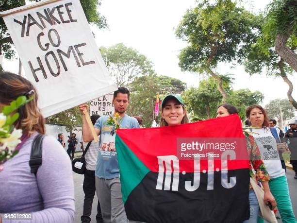 'Yankees Go Home' banner held by activists when thousands of Latin American left wing activists conducted an antiimperialist march against the...