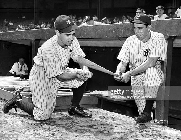 Yankees' Joe DiMaggio gives some batting tips to Daily News reporter Joe Mathias