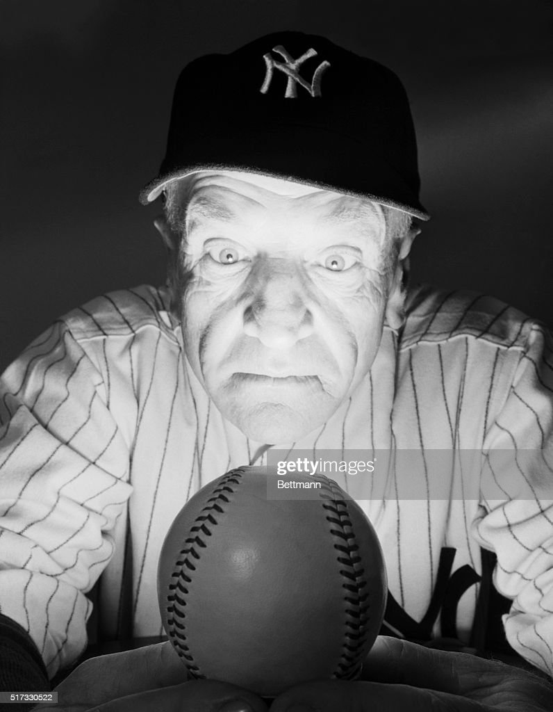 Yankees manager Casey Stengel gazes into a baseball-like 'crystal ball' to predict the fortunes of the team for the year 1949. He said the future looked bright, and his prediction was justified--the Yankees won the World Series that year.
