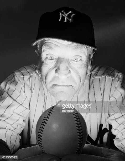 Yankees manager Casey Stengel gazes into a baseballlike 'crystal ball' to predict the fortunes of the team for the year 1949 He said the future...
