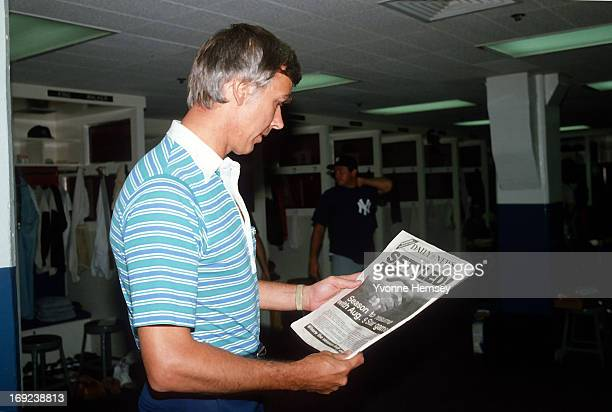 Yankees manager, Gene Michaels, reads the Daily News headlines August 4, 1981 in the Bronx, New York, announcing the baseball strike is over. The...