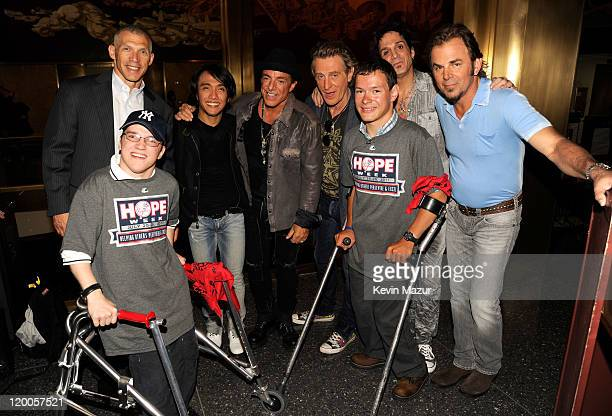 Yankees manager Joe Girardi Arnel Pineda Neal Schon Ross Valory Deen Castronovo and Jonathan Cain of Journey backstage after NBC's Today at...