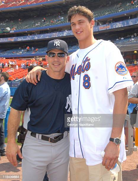Yankees Manager Joe Girardi gets together with New York Knicks first round draft pick Danilio Gallinardi on June 28, 2008 at Shea Stadium in...