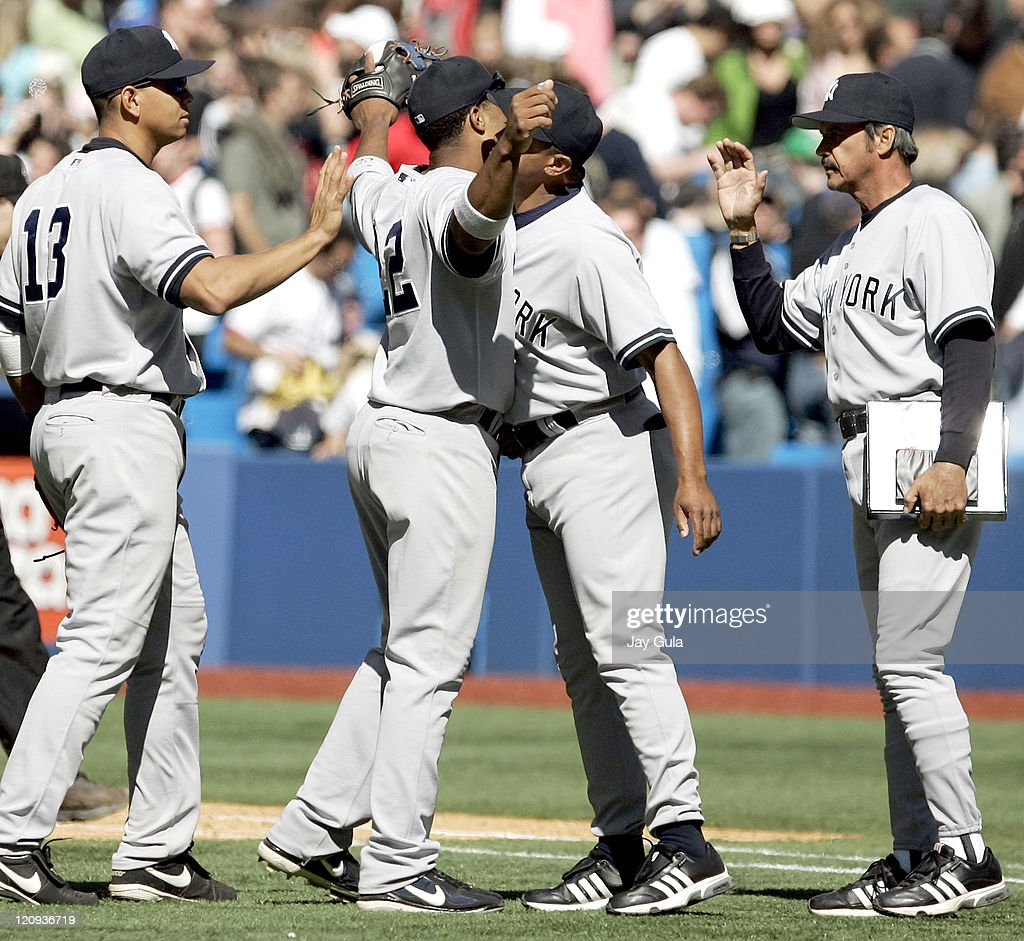NYY Yankees Mariano Rivera and 1B coach Tony Pena congratulate one another after the Yankees 3-1 victory over Toronto during the New York Yankees vs Toronto Blue Jays game on April 19, 2006 at Rogers Centre in Toronto , Canada.
