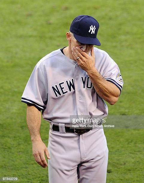 Yankees Mariano Riviera throws to 1st to get runner on bunt but throw gets away from Alex rodriguez all runners safe ALCS Game 3 New York Yankees vs...