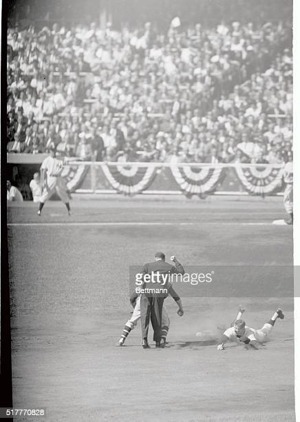 Yankees' Mickey Mantle is a dead duck sliding into second in the first inning of the first world series game at the stadium today Umpire McKinley...