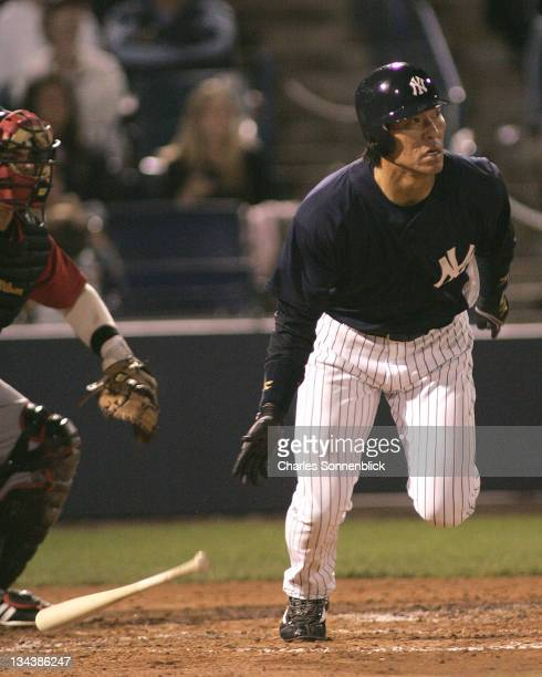 Yankees outfielder Hideki Matsui hits the ball into the outfield for a base hit in a spring training game against the Reds on March 7 2007 at Legends...