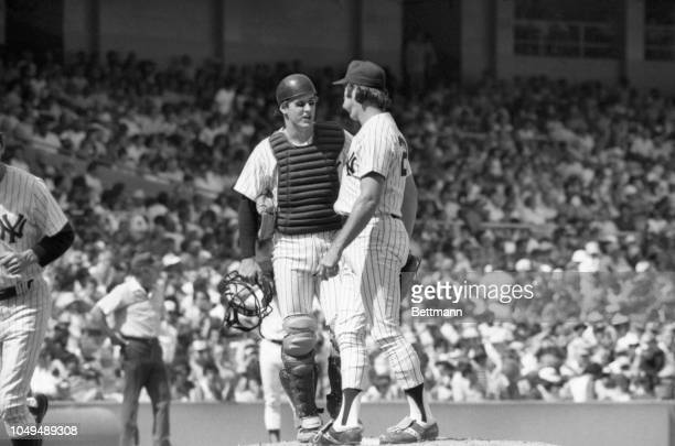 Yankees' rookie Mike Heath checks signals with pitcher Sparky Lyle after he relieved Dirck Tidrow in the 7th inning of game with White Sox. Owner...