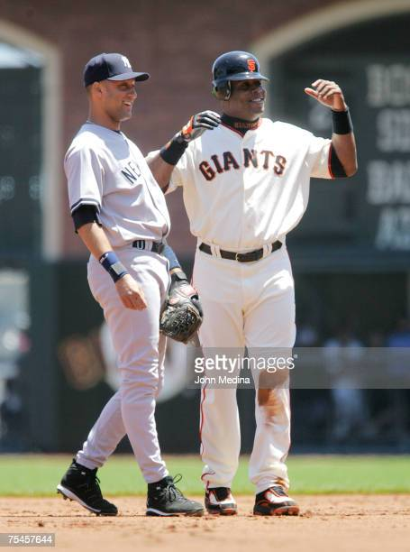 Yankees shortstop Derek Jeter and Giants slugger Barry Bonds share a laugh after Bonds stole second base during the San Francisco Giants 7-2 defeat...