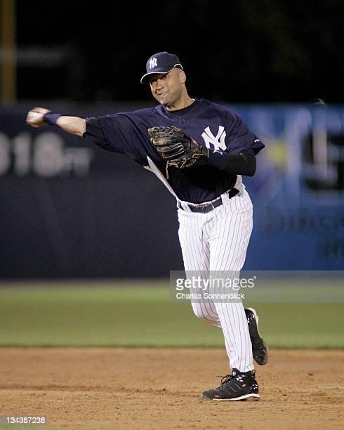 Yankees shortstop Derek Jeter fields a ground ball and throws to first in a spring training game against the Reds on March 7 2007 at Legends Field in...