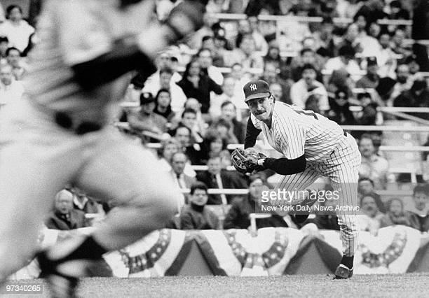 Yankees third baseman Mike Pagliarulo charges to field Al Newman's slow roller and throw out the Minnesota second baseman in the fifth inning.