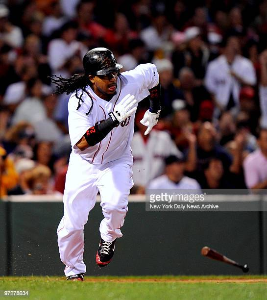 Yankees vs Boston Red Sox at Fenway Park., Boston Red Sox left fielder Manny Ramirez gets an RBI double in the 1st inning scoring Boston Red Sox...