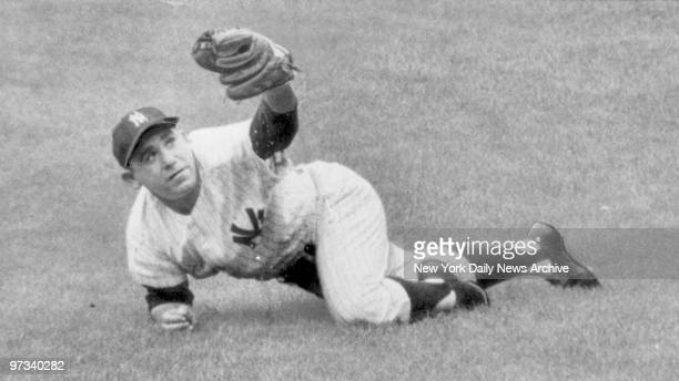 Yankees Yogi Berra makes threepoint landing after snagging short fly to right in third frame of yesterday's tilt with Baltimore at the Stadium Five...