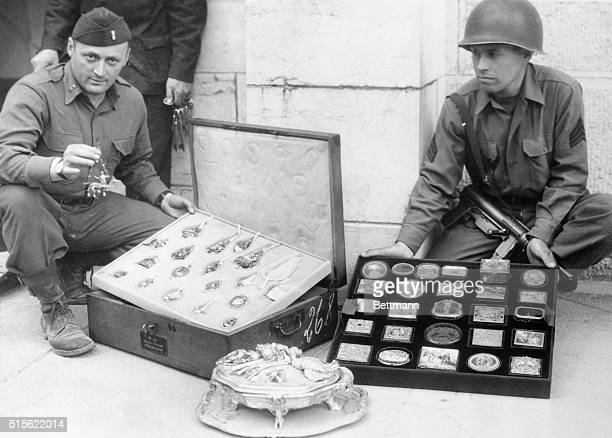 Yanks of the 7th Army unearth looted art treasures hidden by the Nazis. Here is a tray of valuable antique jewelry and a tray of ornaments, snuff...