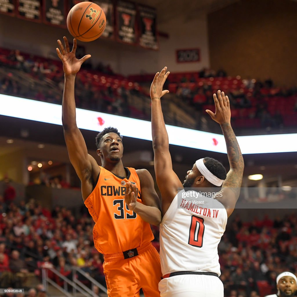 Yankuba Sima #35 of the Oklahoma State Cowboys shoots the ball over Tommy Hamilton IV #0 of the Texas Tech Red Raiders during the second half of the game on January 23, 2018 at United Supermarket Arena in Lubbock, Texas. Texas Tech defeated Oklahoma State 75-70.