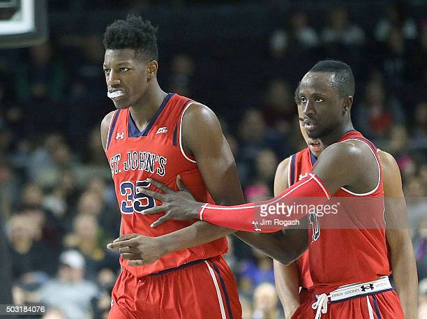 Yankuba Sima of the St John's Red Storm and Felix Balamou react during a game against the Providence Friars in the second half on January 2 at the...