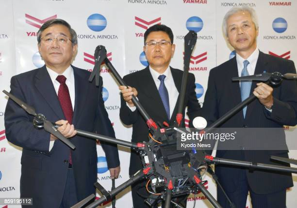 Yanmar Co and Konica Minolta Inc unveil a drone to observe the growth levels of rice crops during a press conference on Sept 29 in Tokyo ==Kyodo