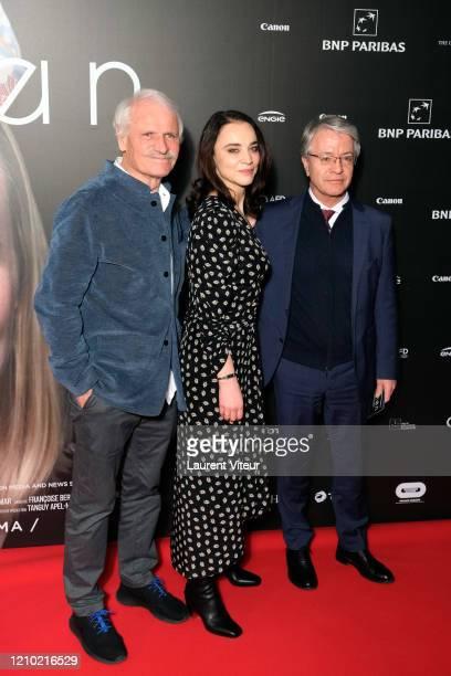 "Yann Arthus-Bertrand, Anastasia Mikova and General Director of BNP Paribas Jean-Laurent Bonnafé attend the ""Woman"" Premiere At UGC Normandie on March..."