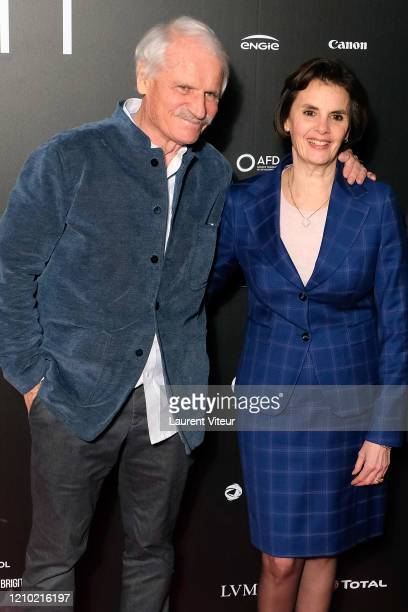 """Yann Arthus-Bertrand and CEO BNP Paribas Sophia Merlo attend the """"Woman"""" Premiere At UGC Normandie on March 03, 2020 in Paris, France."""