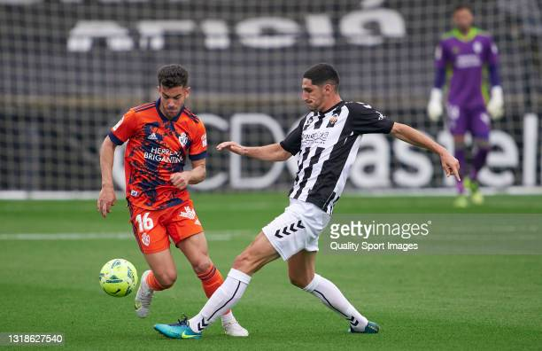 Yann Bodiger of CD Castellon competes for the ball with Curro Sanchez of SD Ponferradina during the Liga Smartbank match betwen CD Castellon and SD...