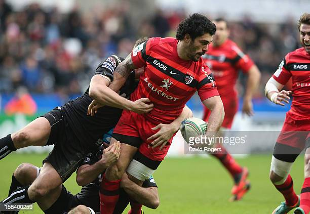 Yann David of Toulouse is tackled during the Heineken Cup match between Ospreys and Stade Toulouse at the Liberty Stadium on December 15 2012 in...