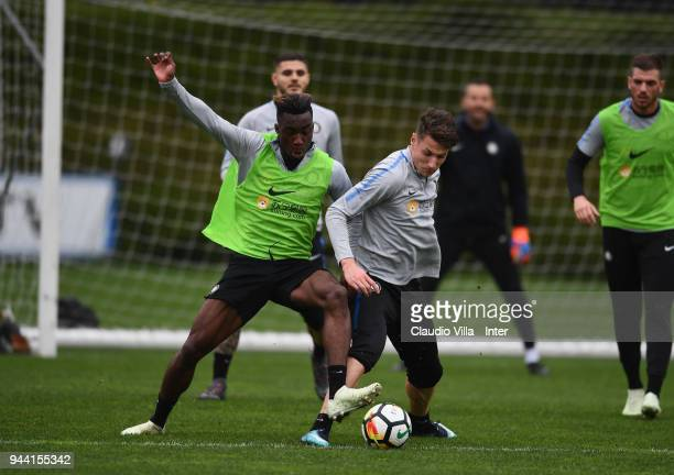 Yann Karamoh and Andrea Pinamonti of FC Internazionale compete for the ball during the FC Internazionale training session at the club's training...