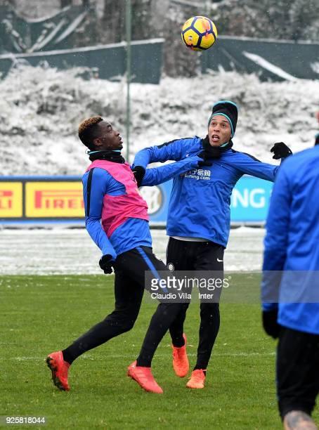 Yann Karamoh and Joao Miranda de Souza Filho of FC Internazionale compete for the ball during the FC Internazionale training session at the club's...