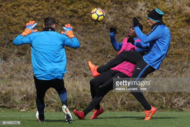 Yann Karamoh is challenged by Joao Miranda during the FC Internazionale training session at the club's training ground Suning Training Center in...