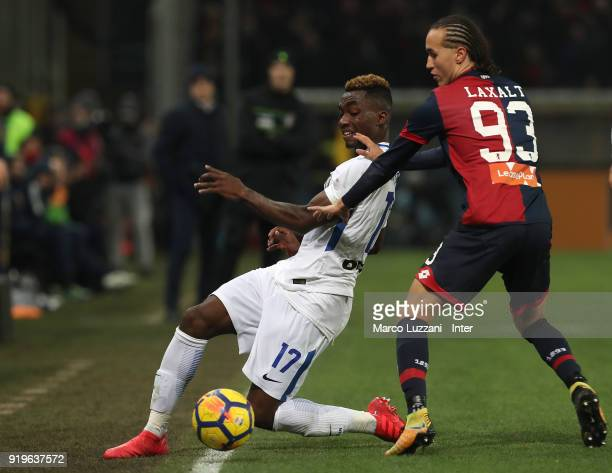 Yann Karamoh of FC Internazionale competes for the ball with Diego Laxalt of Genoa CFC during the serie A match between Genoa CFC and FC...
