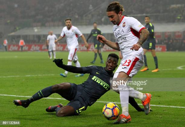 Yann Karamoh of FC Internazionale competes for the ball with Leonardo Nunzella of Pordenone during the TIM Cup match between FC Internazionale and...