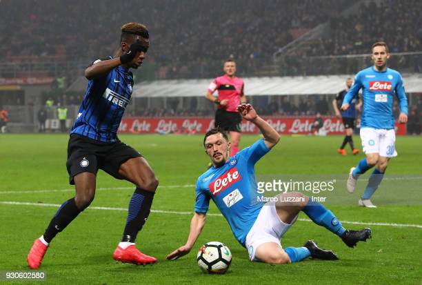 Yann Karamoh of FC Internazionale competes for the ball with Mario Rui of SSC Napoli during the serie A match between FC Internazionale and SSC...